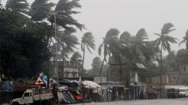 Wind gusting up to 185km/h (115mph) bent palm trees on the Orissa coast