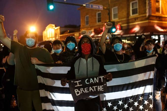 Demonstrators, lifting play cards with slogans 'I can't breathe', rushed to the streets of Minneapolis, in support of justice to an unarmed black man George Floyd, who was detained by the police for being involved in forgery and one of the officer, after banged him in the ground, put their knee on his throat, so he could not breathe. He died right after he was rushed to the hospital.