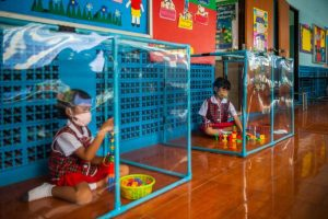 School In Thailand Uses Plastic Pens To Separate Pupils During Pandemic
